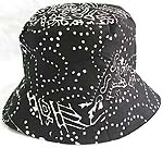Double sided cotton bucket hat, one side of blak with white pattern decor fashion, and flipped over for plain black with zipper design