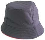 Fashion cotton double sided bucket hat, one side of neutral black, and flipped over for bright red with zipper design