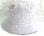 Flippable fashion cotton double sided bucket hat, one side of neutral white, and flipped over for earth tone with zipper design
