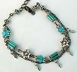 Flower motif double black chain fashion bracelet with clear blue glass bugle beads