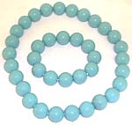 Smooth finishing multi light blue rounded plastic beads forming stretchy fashion necklace and bracelet set