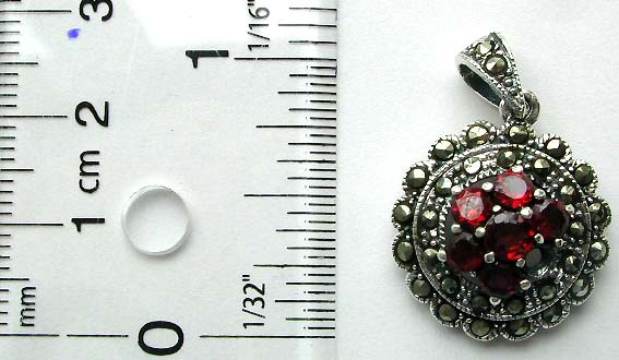 Multi marcasites stone forming double circle pattern sterling silver pendant with multi red garnet stone in middle