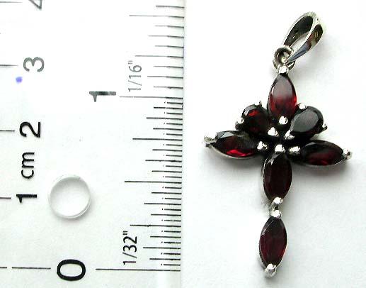 Olive shape red garnet stone forming cross pattern sterling silver pendant