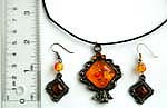 Cotton black rounded cord fashion necklace and earring set with imitation amber