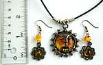 Cotton black rounded cord fashion necklace and earring set with sun face pattern imitation amber pendant