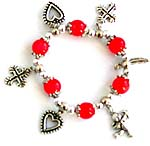 Orange color beaded strecthy charm bracelet with cross, leaf, heart and Apolo angel and leaf pattern