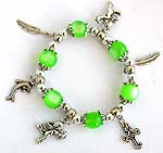 Green beaded strecthy charm bracelet with cross, leaf, dolphin, and Apolo angel pattern