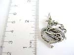 Stamped 925.sterling silver dragon pendant in curvy movement