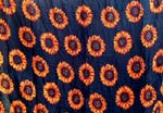 Orange sunflower design in black background color