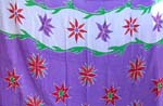 Purple color with orange flower and red and purple decor each side